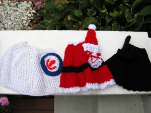 Cubs jersey, Santa Claus, and Witch costume
